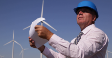 location-manager-engineer-man-work-examine-technical-drawing-plans-wind-turbine_v_ec_ue_og__F0006